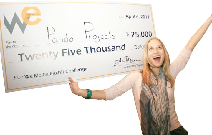 Milena with her big check.