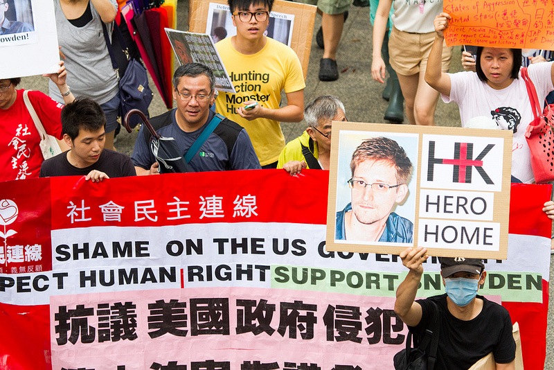 Demonstrators in Hong Kong march in support of former US government contractor Edward Snowden on June 15, 2013. Photo Credit: See-ming Lee / Creative Commons